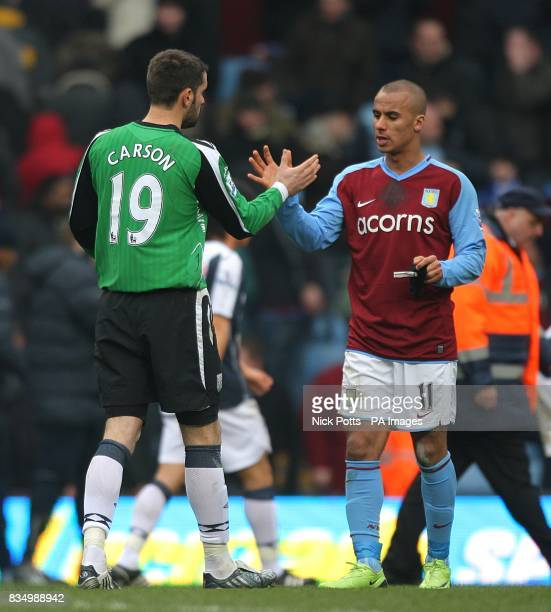 Aston Villa's Gabriel Agbonlahor shakes hands with West Bromwich Albion goalkeeper Scott Carson after the final whistle