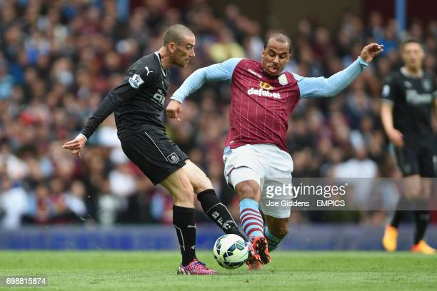 Aston Villa's Gabriel Agbonlahor tackles Burnley's David Jones