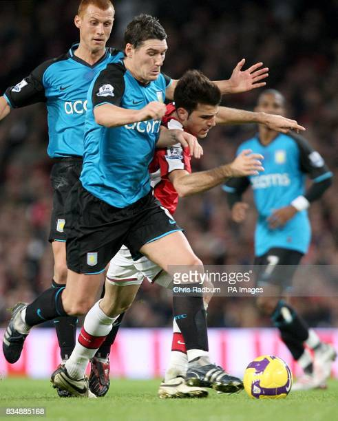 Aston Villa's Gareth Barry and Arsenal's Cesc Fabregas in action