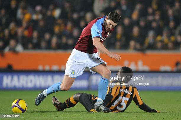 Aston Villa's Gareth Barry and Hull City's Bernard Mendy battle for the ball