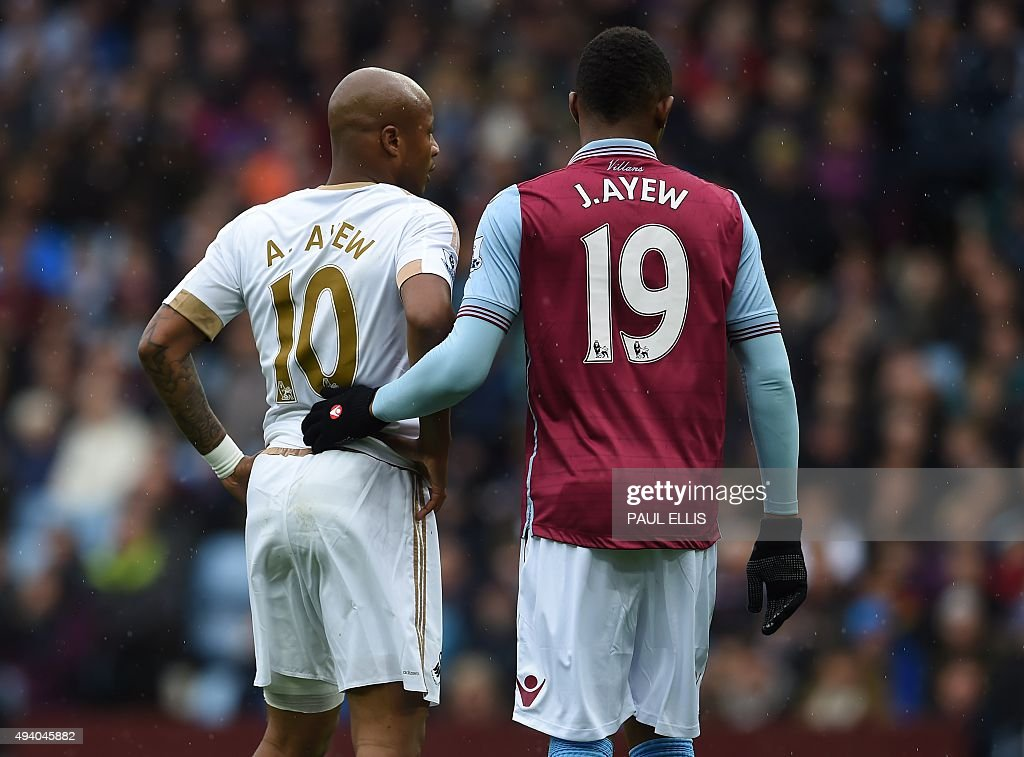 Aston Villa's Ghanaian striker Jordan Ayew (R) marks his brother Swansea City's Ghanaian striker Andre Ayew (L) at a corner during the English Premier League football match between Aston Villa and Swansea City at Villa Park in Birmingham, central England on October 24, 2015. USE. No use with unauthorized audio, video, data, fixture lists, club/league logos or 'live' services. Online in-match use limited to 75 images, no video emulation. No use in betting, games or single club/league/player publications.
