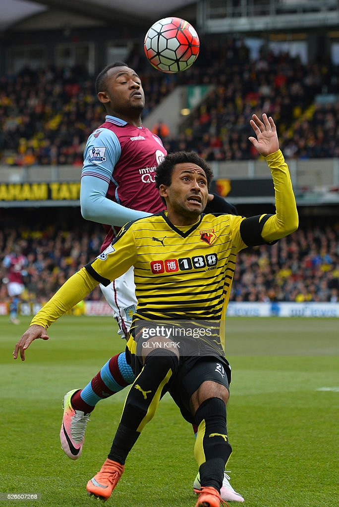 Aston Villa's Ghanaian striker Jordan Ayew (back) vies with Watford's Scottish midfielder Ikechi Anya during the English Premier League football match between Watford and Aston Villa at Vicarage Road Stadium in Watford, north of London on April 30, 2016. / AFP / GLYN KIRK / RESTRICTED TO EDITORIAL USE. No use with unauthorized audio, video, data, fixture lists, club/league logos or 'live' services. Online in-match use limited to 75 images, no video emulation. No use in betting, games or single club/league/player publications. /