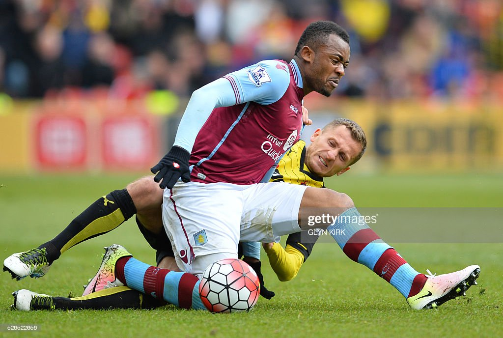 Aston Villa's Ghanaian striker Jordan Ayew (L) vies with Watford's Yugoslavian-born Swiss midfielder Almen Abdi during the English Premier League football match between Watford and Aston Villa at Vicarage Road Stadium in Watford, north of London on April 30, 2016. / AFP / GLYN KIRK / RESTRICTED TO EDITORIAL USE. No use with unauthorized audio, video, data, fixture lists, club/league logos or 'live' services. Online in-match use limited to 75 images, no video emulation. No use in betting, games or single club/league/player publications. /