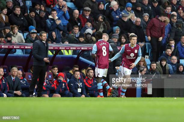 Aston Villa's Idrissa Gueye is substituted for team mate Jack Grealish as manager Remi Garde stands at the touchline
