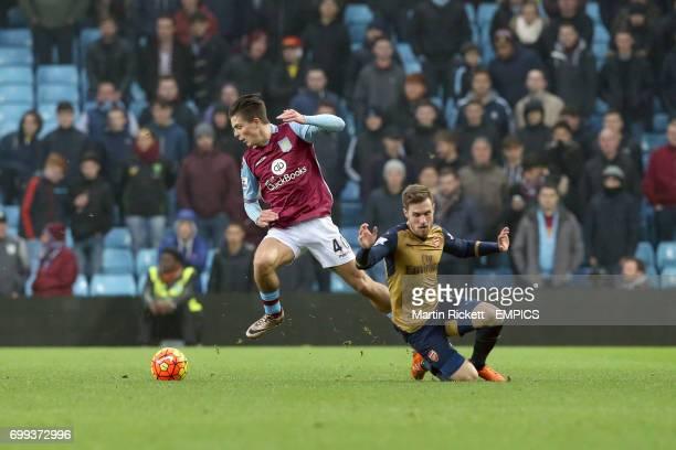 Aston Villa's Jack Grealish and Arsenal's Aaron Ramsey battle for the ball