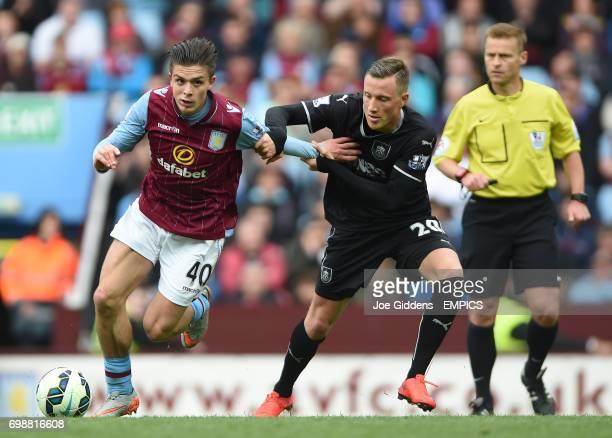 Aston Villa's Jack Grealish and Burnley's Fredrik Ulvestad battle for the ball