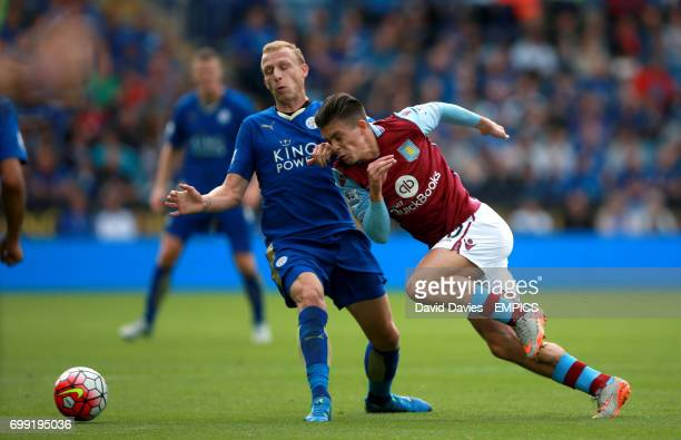 Aston Villa's Jack Grealish and Leicester City's Ritchie De Laet battle for the ball
