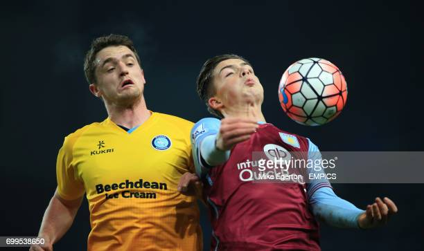 Aston Villa's Jack Grealish and Wycombe Wanderers' Stephen McGinn battle for the ball