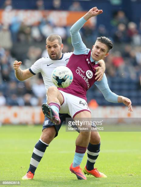 Aston Villa's Jack Grealish battles for the ball with Preston North End's John Welsh