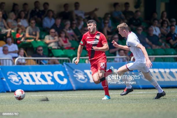 Aston Villa's Jacob Bedeau competes with Bayer Leverkusen's Guven Yalcin for a ball during their Main Tournament match part of the HKFC Citi Soccer...
