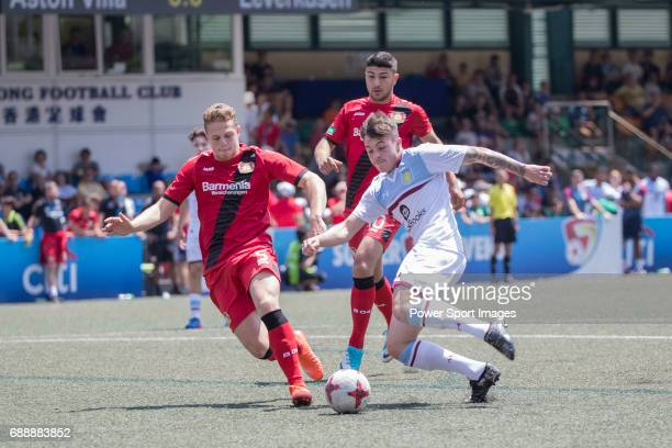 Aston Villa's Jacob Bedeau competes with Bayer Leverkusen's Joel AbuHanna for a ball during their Main Tournament match part of the HKFC Citi Soccer...