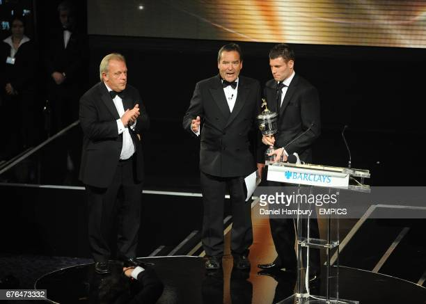 Aston Villa's James Milner with his PFA Young Player of the Year award on stage with PFA Chief Executive Gordon Taylor and Jeff Stelling at the PFA...