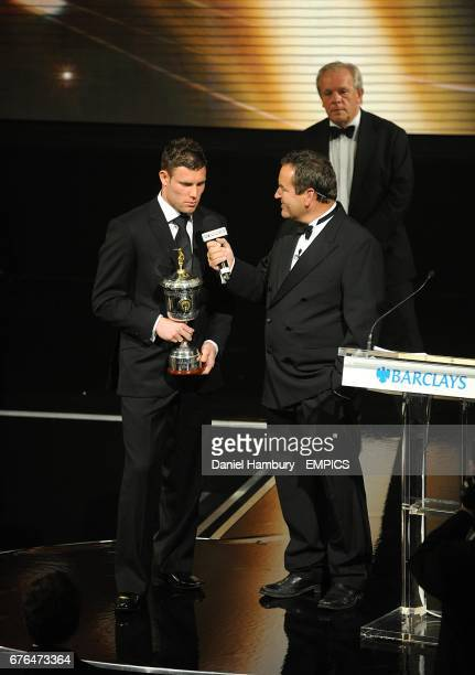 Aston Villa's James Milner with his PFA Young Player of the Year award on stage with Jeff Stelling at the PFA Player of the Year Awards 2010 at the...