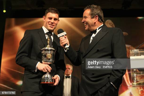 Aston Villa's James Milner with his PFA Young Player of the Year trophy speaks to Jeff Stelling at the PFA Player of the Year Awards 2010 at the...