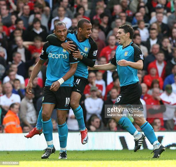 Aston Villa's John Carew celebrates scoring his sides first goal of the game with teammates Gabriel Agbonlahor and Gareth Barry