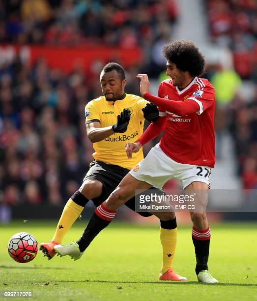 Aston Villa's Jordan Ayew and Manchester United's Marouane Fellaini battle for the ball
