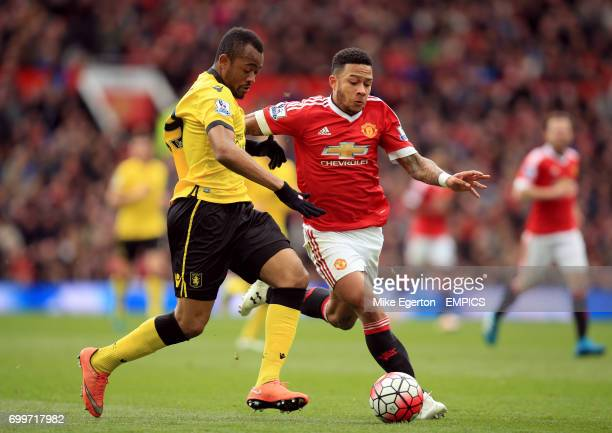 Aston Villa's Jordan Ayew and Manchester United's Memphis Depay battle for the ball