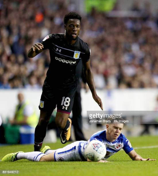 Aston Villa's Josh Onomah tackles Reading's Liam Kelly during the Sky Bet Championship match at the Madjeski Stadium Reading