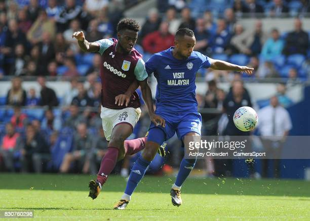Aston Villa's Joshua Onomah vies for possession with Cardiff City's Loic Damour during the Sky Bet Championship match between Cardiff City and Aston...