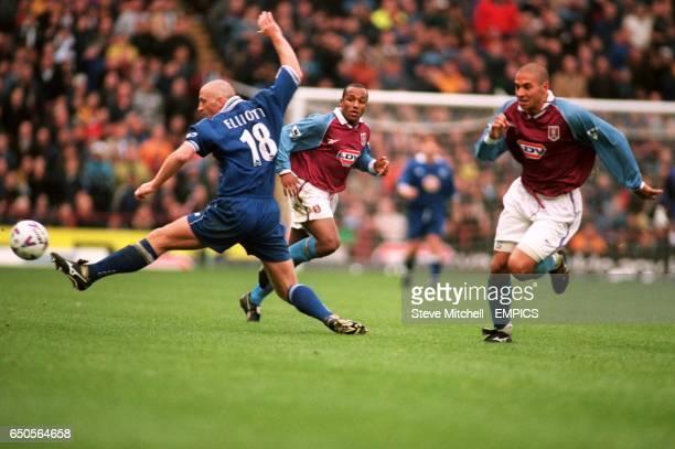 Aston Villa's Julian Joachim looks on as Leicester City's Matt Elliott narrowly fails to intercept a pass for Aston Villa's Stan Collymore