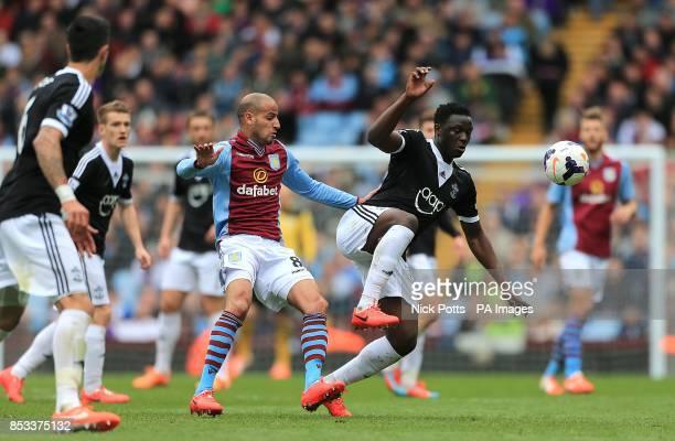 Aston Villa's Karim El Ahmadi and Southampton's Victor Wanyama battle for the ball
