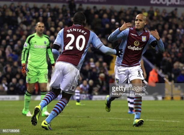 Aston Villa's Karim El Ahmadi celebrates scoring his teams opening goal with teammate Christian Benteke during the Barclays Premier League match at...