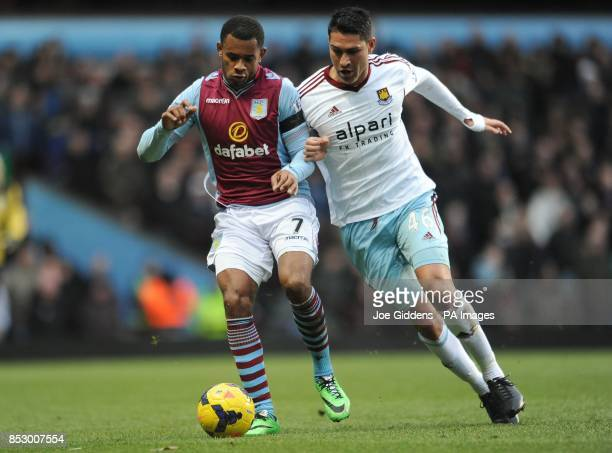 Aston Villa's Leandro Bacuna and West Ham United's Marco Borriello battle for the ball during the Barclays Premier League match at Villa Park...
