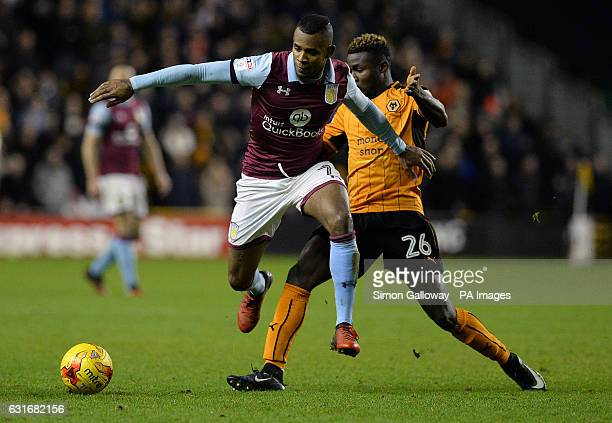 Aston Villa's Leandro Bacuna and Wolverhampton Wanderers' Bright Enobakhare battle for the ball during the Sky Bet Championship match at Molineux...