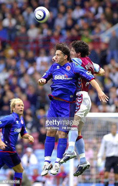 Aston Villa's Liam Ridgewell battles in the air with Middlesbrough's Fabio Rochemback during the Barclays Premiership match at Villa Park Birmingham...