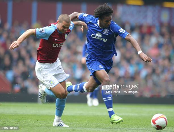 Aston Villa's Luke Young and Everton's Gabriel Agbonlahor battle for the ball