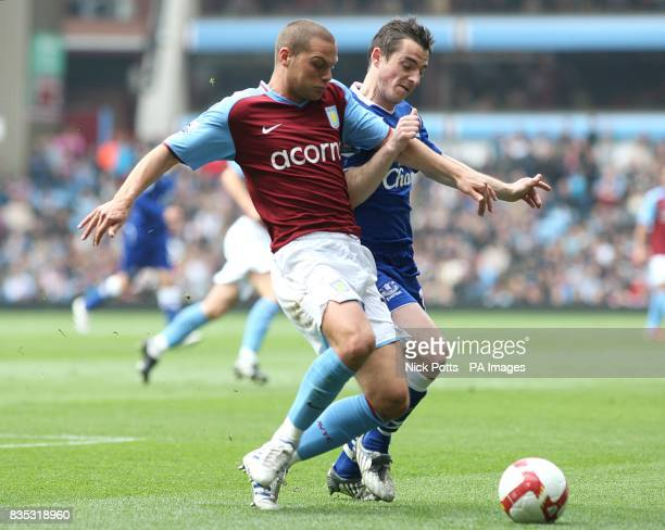 Aston Villa's Luke Young and Everton's Leighton Baines battle for the ball
