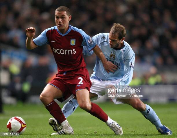 Aston Villa's Luke Young and Manchester City's Pablo Zabaleta battle for the ball