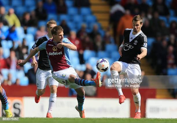 Aston Villa's Marc Albrighton and Southampton's Morgan Schneiderlin battle for the ball
