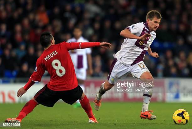 Aston Villa's Marc Albrighton beats Cardiff City's Gary Medel
