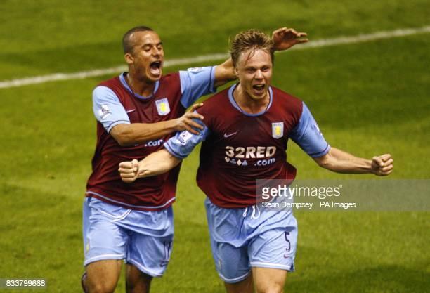 Aston Villa's Martin Laursen celebrates his second goal with Gabriel Agbonlahor