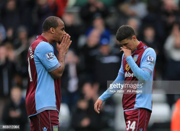 Aston Villa's Matthew Lowton and Gabriel Agbonlahor appear dejected