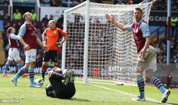 Aston Villa's Nathan Baker reacts after fouling Liverpool's Luis Suarez to concede a penalty