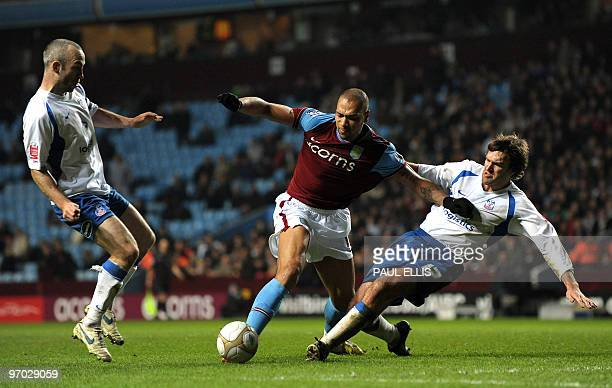 Aston Villa's Norweigan forward John Carew is fouled by Crystal Palace's Matthew Lawrence for a penalty during their English FA Cup fifth round...
