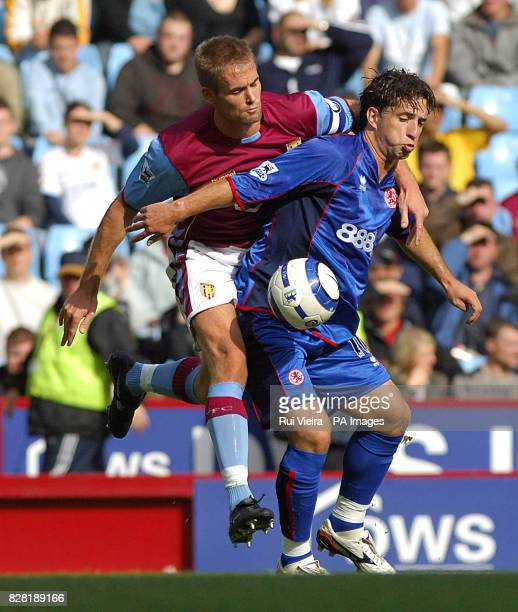 Aston Villa's Olof Mellberg challenges Middlesbrough's Fabio Rochemback during the Barclays Premiership match at Villa Park Birmingham Sunday October...
