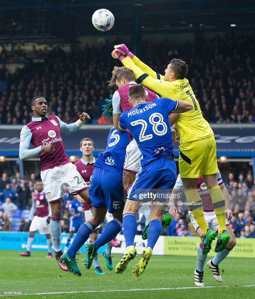 Aston Villa's Pierluigi Gollini punches the ball clear under pressure from Birmingham City's Michael Morrison during the Sky Bet Championship match between Birmingham City and Aston Villa at St Andrews (stadium) on October 30, 2016 in Birmingham, England.