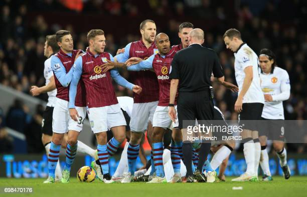 Aston Villa's players protest the decision of referee Mr Lee Mason to send off Gabby Agbonlahor against Manchester United