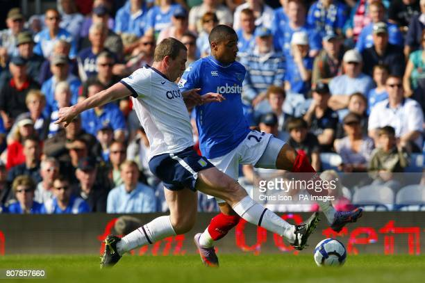 Aston Villa's Richard Dunne and Portsmouth's KevinPrince Boateng battle for the ball