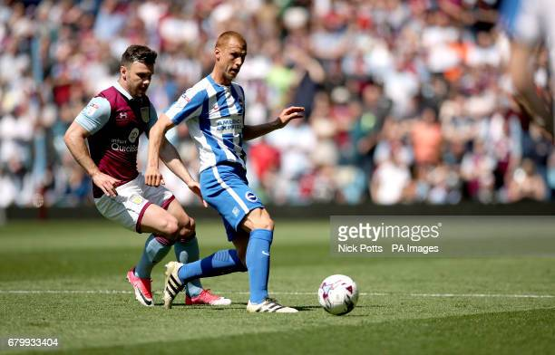 Aston Villa's Scott Hogan and Brighton Hove Albion's Steve Sidwell battle for the ball during the Sky Bet Championship match at Villa Park Birmingham