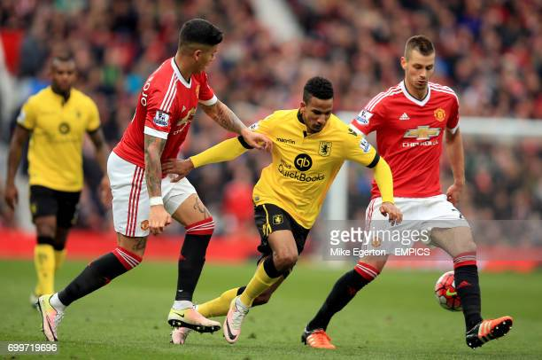 Aston Villa's Scott Sinclair battles for the ball with Manchester United's Marcos Rojo and Morgan Schneiderlin