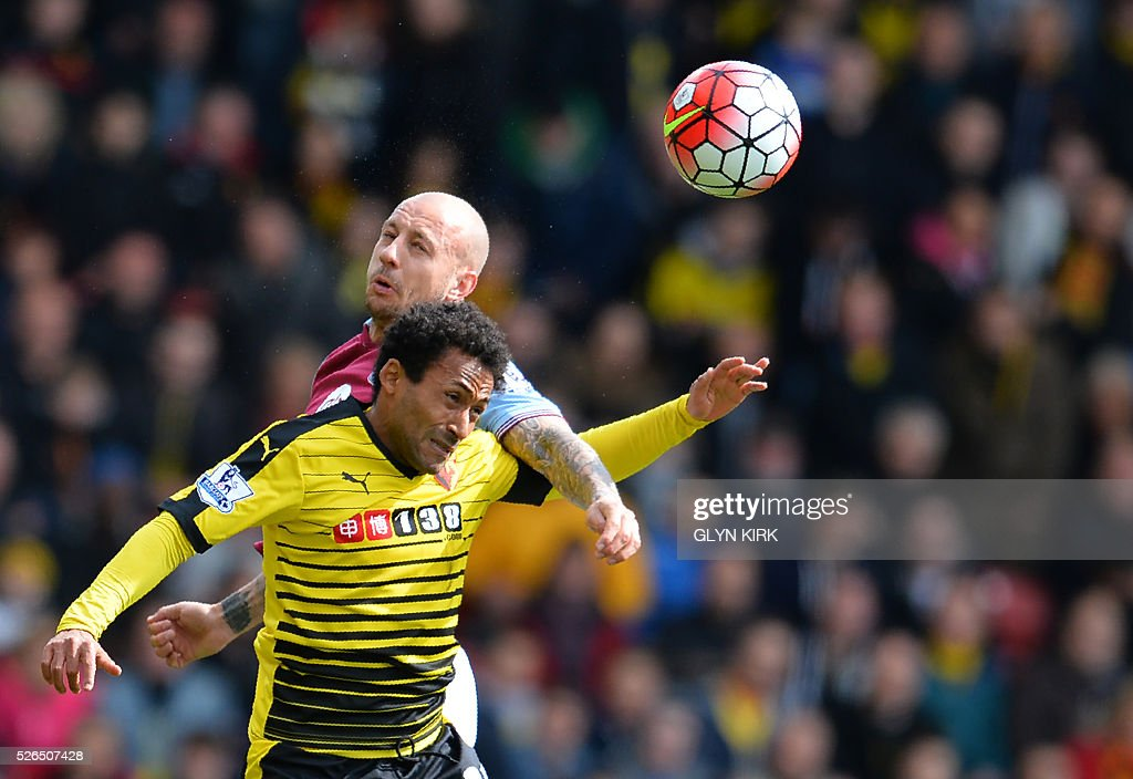 Aston Villa's Scottish defender Alan Hutton (L) jumps for a header with Watford's Scottish midfielder Ikechi Anya during the English Premier League football match between Watford and Aston Villa at Vicarage Road Stadium in Watford, north of London on April 30, 2016. / AFP / GLYN KIRK / RESTRICTED TO EDITORIAL USE. No use with unauthorized audio, video, data, fixture lists, club/league logos or 'live' services. Online in-match use limited to 75 images, no video emulation. No use in betting, games or single club/league/player publications. /