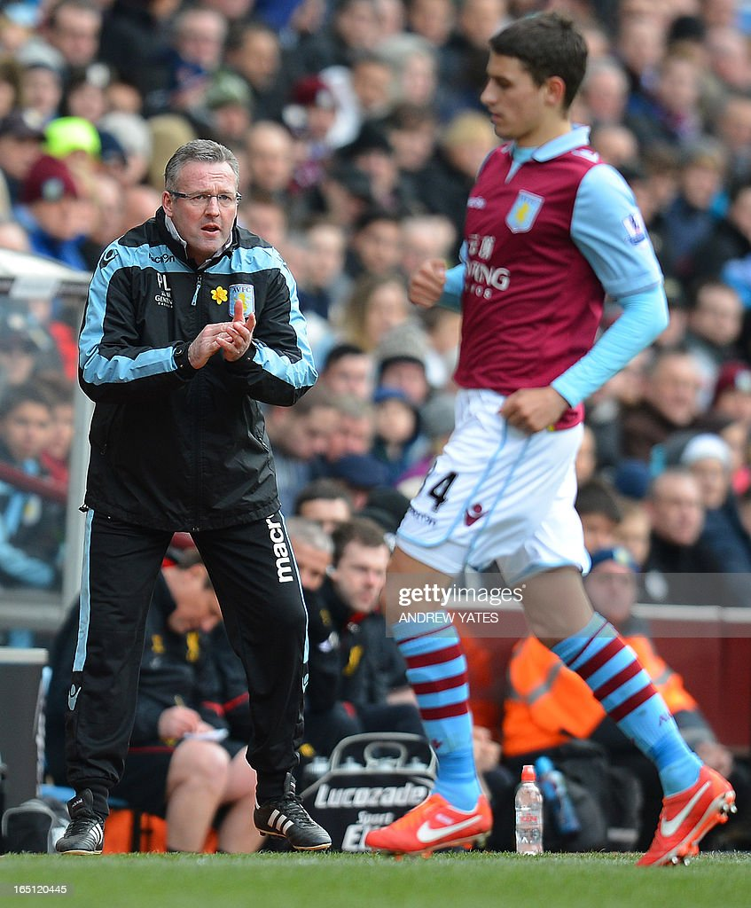 """Aston Villa's Scottish manager Paul Lambert (L) reacts during the English Premier League football match between Aston Villa and Liverpool at Villa Park in Birmingham, West Midlands, England on March 31, 2013. Liverpool won the game 2-1. AFP PHOTO/ANDREW YATES USE. No use with unauthorized audio, video, data, fixture lists, club/league logos or """"live"""" services. Online in-match use limited to 45 images, no video emulation. No use in betting, games or single club/league/player publications."""