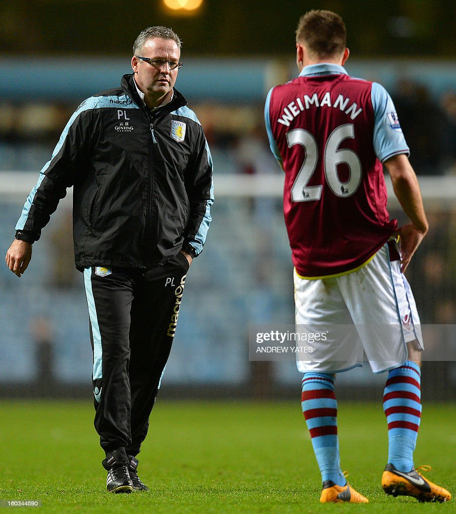 """Aston Villa's Scottish manager Paul Lambert (L) speaks to Aston Villa's Austrian striker Andreas Weimann after the final whistle in the English Premier League football match between Aston Villa and Newcastle United at Villa Park in Birmingham, West Midlands, England on January 29, 2013. Newcastle won the game 2-1. USE. No use with unauthorized audio, video, data, fixture lists, club/league logos or """"live"""" services. Online in-match use limited to 45 images, no video emulation. No use in betting, games or single club/league/player publications."""