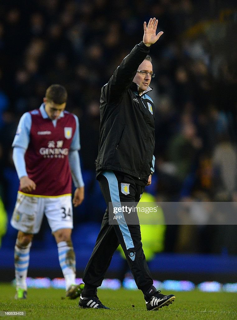 """Aston Villa's Scottish manager Paul Lambert (R) waves to the fans after the 3-3 draw during the English Premier league football match between Everton and Aston Villa at Goodison Park in Liverpool, north-west England on February 2, 2013. AFP PHOTO/ANDREW YATES RESTRICTED TO EDITORIAL USE. No use with unauthorized audio, video, data, fixture lists, club/league logos or """"live"""" services. Online in-match use limited to 45 images, no video emulation. No use in betting, games or single club/league/player publications."""