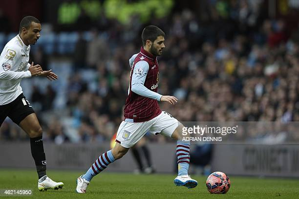 Aston Villa's Spanish midfielder Carles Gil runs with the ball during the FA Cup fourth round football match between Aston Villa and Bournemouth at...