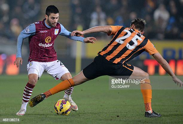 Aston Villa's Spanish midfielder Carles Gil vies for the ball with Hull City's Uruguayan midfielder Gaston Ramirez during the English Premier League...